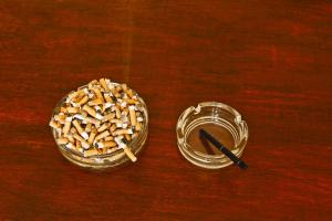 Electronic cigarette and cigarettes in ashtrays